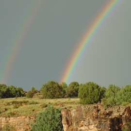 DOUBLE RAINBOW ON ROCKY HILL by SHARON ARMIJO - Landscapes Weather ( hills, rainbows, trees, rocks, thunder storms )