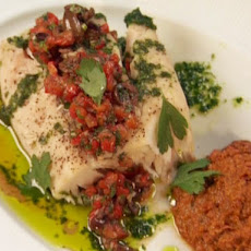 Steamed Wild Striped Bass with Yellow Pepper Romesco, Red Pepper-Black Olive Relish and Parsley-Garlic Oil