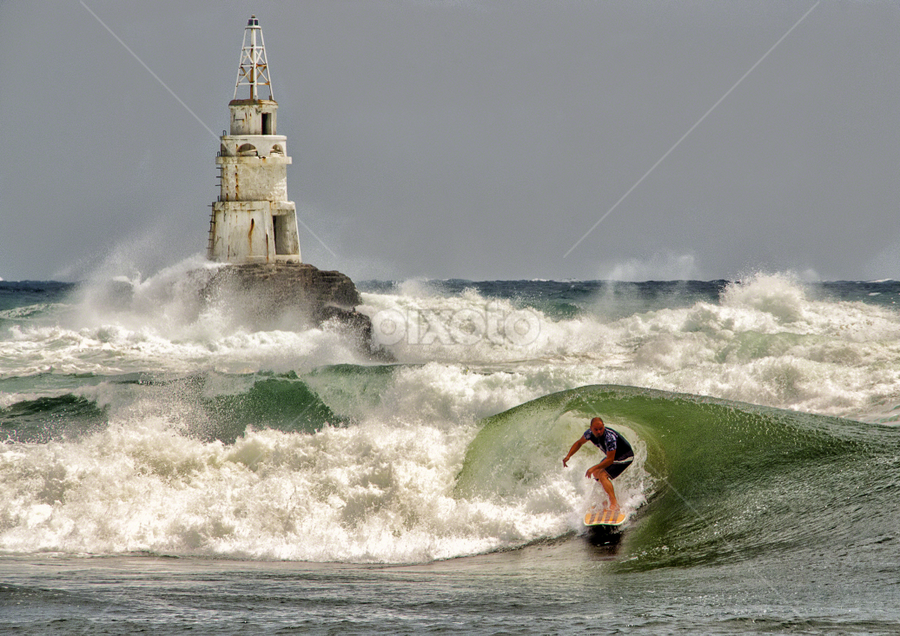 Surfing near the lighthouse by Anton Donev - Sports & Fitness Surfing ( black sea, surfing, ahtopol, lighthouse, wave, sport, sea, man, bulgaria )