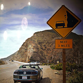 Dangerous Curves by Tricia Scott - Landscapes Travel ( sign, pacific coast, pch, vacation, california, road trip, pacific ocean, roadsign, road, travel, roadside, convertible )