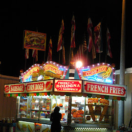Food at the fair by Kaye Petersen - City,  Street & Park  Amusement Parks ( lights, sausage, fries, corn dog, food, night, fair, Lighting, moods, mood lighting )