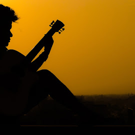 Sunyata Sunset by Naveen Rai - People Musicians & Entertainers ( sunset, silhouette, musician,  )