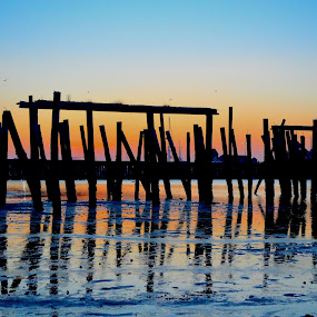 by Rob Kovacs - Novices Only Landscapes ( water, reflection, ptown, cape code, pier, beach, sunrise, abandoned, provincetown, , serenity, blue, mood, factory, charity, autism, light, awareness, lighting, bulbs, LIUB, april 2nd )