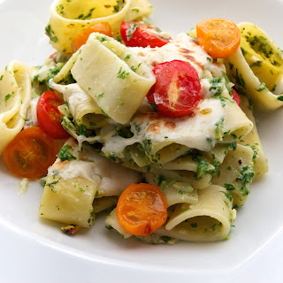 Baked Calamarata Pasta with Arugula Pesto, Almonds, Fresh Mozzarella & Cherry Tomatoes