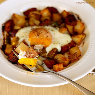 Baked Egg over Roasted Potatoes and Sausage