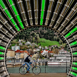 Green Shot! by Jesus Giraldo - City,  Street & Park  Street Scenes ( urban, concept, bike, street, art, lake, beauty, colorfull, bregenz, man, tunnel, city )