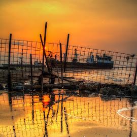 wave reflection boat by Tito Pradipta - Transportation Boats ( reflection, indonesia, sunset, beach, boat )
