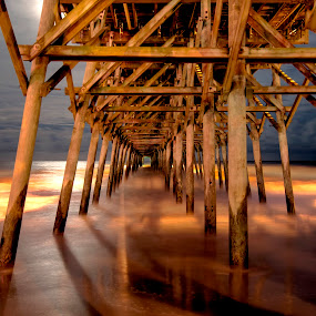 Under the Pier by Cathie Crow - Buildings & Architecture Bridges & Suspended Structures ( fine art, ocean, landscape, photography, nightscape, night photography, nature, super moon, long exposure photography, fine art photography, pier, landscape photography, long exposure, nature photography, night )