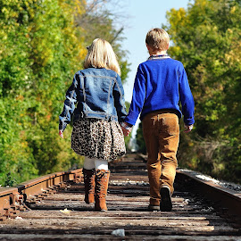 Heading to Grandmas  by Dennis McClintock - Babies & Children Child Portraits ( train tracks, children portrait, walking, children, people )