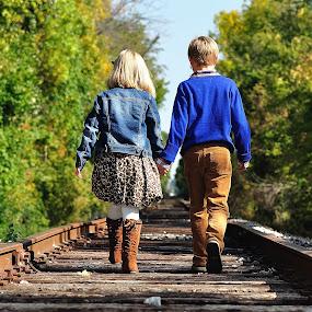 Heading to Grandmas  by Dennis McClintock - Babies & Children Child Portraits ( train tracks, children portrait, walking, children, people )