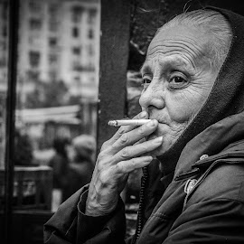 Every wrinkle unfolds a life story by Adrian Mitu - People Street & Candids ( cigarette, face, b&w, smoking, woman, street, duplex istanbul bucharest on spot photo walk, candid )
