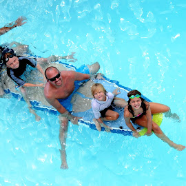 Fun in the pool by Tyrell Heaton - People Family ( pool, family, fun, fathers )