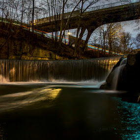 Jones Falls and Light Rail by Aaron Krosner - Landscapes Waterscapes ( water, raw, waterfalls, waterfall, light rail, reflections, baltimore city, jones falls waterfall, 28th street bridge, lights, pure, nature, maryland, night, long exposure, bridge, tripod, bridges, river )