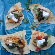 Chile Colorado Tostadas with Pumpkin Seed and Cilantro