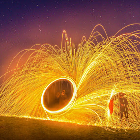Spinning Fire by Srdjan Vujmilovic - Abstract Fire & Fireworks ( canon, home, person, mask, yellow, house, canon eos, people, photography, lights, time, eos, spinning, night photography, performance, photographer, dark, darkness, light, fields, cool, orange, grass, colors, umbrella, star, photo, fire, nightscape, field, light painting, color, stars, night,  )