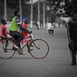 Going together by Avelino Vieira - City,  Street & Park  Street Scenes ( african, cuamba, mozambique, people, bicycle, selective color, pwc )