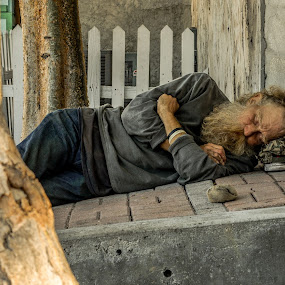 Key West afternoon nap by David Whitehead - People Street & Candids ( sad, street, key west, travel, beach, people, sun, street photography, urban, homeless, hot, world, outside, Travel, People, Lifestyle, Culture )