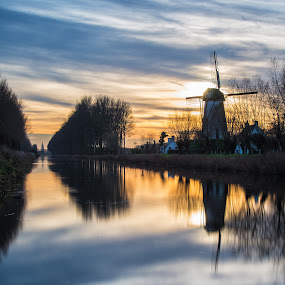 Sunset at Damme by Colin Dixon - Landscapes Waterscapes ( water, sunset, belgium, damme, glow, windmill )