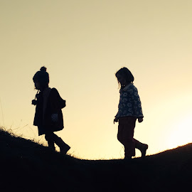 Silhouette sisters. by Kinvara Jennings - Babies & Children Children Candids ( silhouette sisters children outside walking adventure )