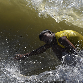 A  surfer trapped in the waves by Arvind Akki - Sports & Fitness Surfing ( water, surfer, waves )