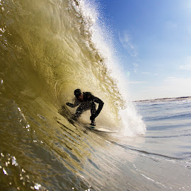 Ben getting barreled  by Dave Nilsen - Sports & Fitness Surfing