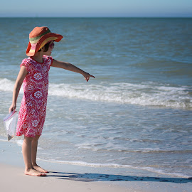Right There! by Jennifer Bacon - Babies & Children Children Candids ( shells, girl, candid, ocean, pointing, beach, pretty, hat )