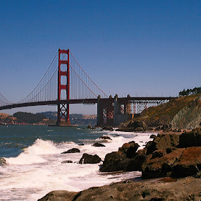 Golden Gate Bridge by Ron Jnr - Buildings & Architecture Bridges & Suspended Structures ( sea waves, photograph, blue sky, golden gate bridge, the bay, waves, bridge, usa, san francisco, rocks )