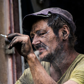 The charcoal worker by Ruxandra Antal - People Portraits of Men ( charcoal, sadness, smoking, charcoal worker )