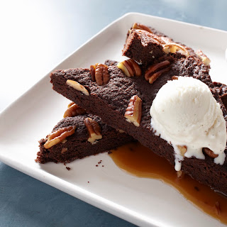 Bittersweet Pecan Brownies With Caramel Sauce