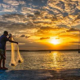 The Fisherman and the sun by Alexandre Carvalho - Landscapes Sunsets & Sunrises ( sunset, nikon d600, nikkor 16-35, fisherman, light, sun )