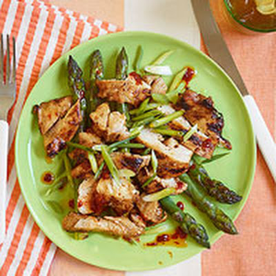 Grilled Sweet-and-Sticky Chicken Thighs with Asparagus and Harissa