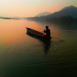 The Boatman  by Prince Frankenstein - Instagram & Mobile Android ( boating, hills, mobile photos, sunset, lake )