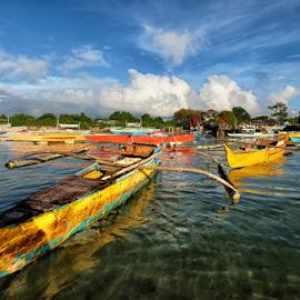 Fleet of Fishing Boats by Ferdinand Ludo - Transportation Boats ( fleet, multicolored boats, mactan island, cordoba )