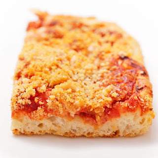 Sfincione (Sicilian New Years Pizza with Bread Crumbs, Onions, and Caciocavallo)