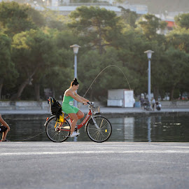 morning by Dan Dumitrescu - City,  Street & Park  Street Scenes ( woman, street, morning, bicycle, street photography )