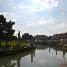 Prato della Valle - Padova by Petar Paljaga - City,  Street & Park  City Parks ( clouds, park, grass, green, statues, canal, padova, sky, italia, padua, trees, italy, river )