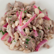 BRAISED PORK WITH WHITE BEANS AND PICKLED RED ONION