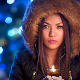 getting warm by Ivan Lee - People Portraits of Women ( canon, candle, model, girl, beauty, coat )