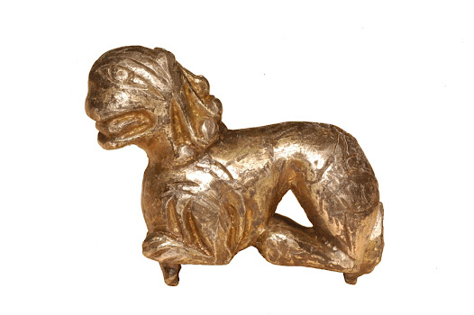 This object is a Romanesque fitting in the form of a crouching lion. It may have mounted a shrine or casket. Caskets were often present at important religious and secular events, such as when Harold swore a sacred oath before Duke William.