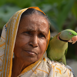 by Ajay Halder - People Street & Candids ( woman with parrot, pet parrot )