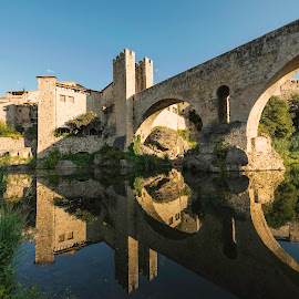 Besalu, Girona by Liam Coburn Dunne - Buildings & Architecture Bridges & Suspended Structures ( nikon 14-24, reflection, blue sky, besalu, nikon d800, peace, bridge, town, medieval )