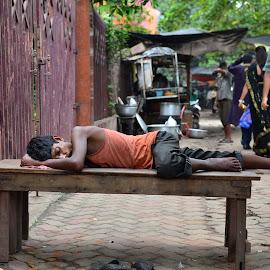 and he sleeps peacefully by Anamitra Ghosh - People Street & Candids ( peaceful, prime lens, kolkata, innocence, tranquility, sleep, nikon, man, street photography )