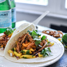 Crockpot BBQ Beer Pulled Pork Tacos with Crispy Onion Straws and Mango Salsa