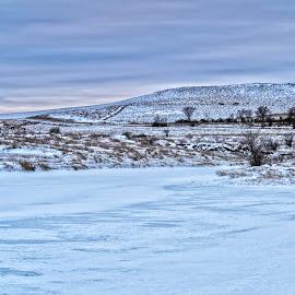 Krieg's Pond  by Julie Wooden - Landscapes Waterscapes ( winter, north dakota, krieg's pond, blue, ice, hebron, cloudy, sunrise )