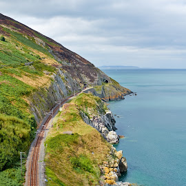 Bray Cliff Walk by Dejan Deko - Landscapes Mountains & Hills ( railing, mountain, freedom, bray, bright, tranquil scene, eurorail, rock, beach, cityscape, travel, heat, hiking, exploration, city, railroad station platform, nature, rock and roll, train, northern ireland, travel destinations, cliff, journey, happiness, tourism, wide, beauty in nature, sunlight, peace on earth, urban scene, brightly lit, tourist, water's edge, rural scene, day, panoramic, tunnel, walking, europe, republic of ireland, beauty, landscape, coastline, island, sunny, vibrant color, eyesight, cliffwalk;, railroad track, non-urban scene, scenics, irish culture, sea, landscaped, blue, greystone, summer )