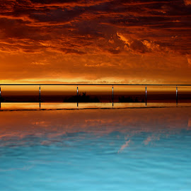 swimming pool at sunset by Magdalena Wysoczanska - Artistic Objects Other Objects ( water, sky, red, blue, bright, colorful, colors, sunset, swimming pool )