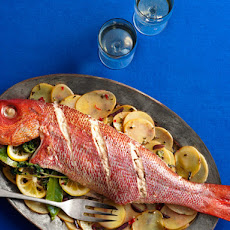 Whole Roasted Fish With Sliced Potatoes, Olives and Herbs
