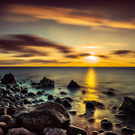On shore. by Hallgrimur Helgason - Landscapes Beaches ( ray, rocks.clouds, sky, sunset, shoreline, sea, sun, landscape, beach )
