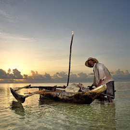 Sunrise Fishing by Andrew Morgan - Landscapes Travel ( dhow, zanzibar, boats, seascape, sunrise, fisherman, ocean view )