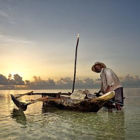Sunrise Fishing by Andrew Morgan - People Street & Candids ( dhow, zanzibar, boats, seascape, sunrise, fisherman, ocean view )
